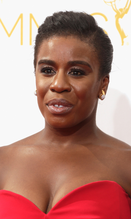 Crazy Eyes no more! Uzo Aduba's chic updo is a far cry from her 'Orange Is The New Black' character's signature buns, and with her smokey eyes and glossed lips we'd never peg her for an inmate! © Getty