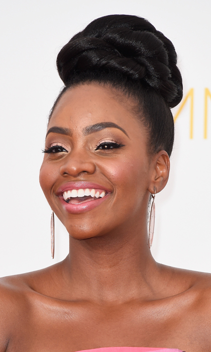 'Mad Men' actress Teyonah Parris put her hair to the sky in an intricate top-knot and accentuated her deep brown eyes with a sultry cat eye. © Getty