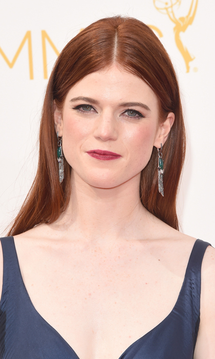 Living in the mountains, Rose Leslie's arrow-slinging character on 'Game of Thrones' if not one to style her hair. We're loving this sleek and straight 'do and its berry-stained companions. © Getty