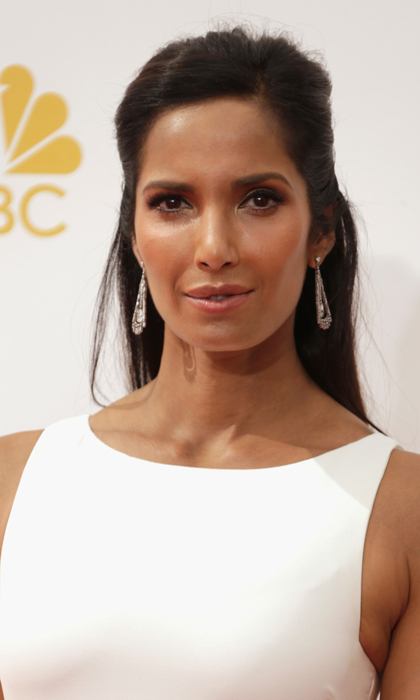 With a face like this you don't need much in the way of makeup, and Padma Lakshmi kept it simple with dewy skin, smoky eyes and her side-parted hair partially pulled back. © Getty
