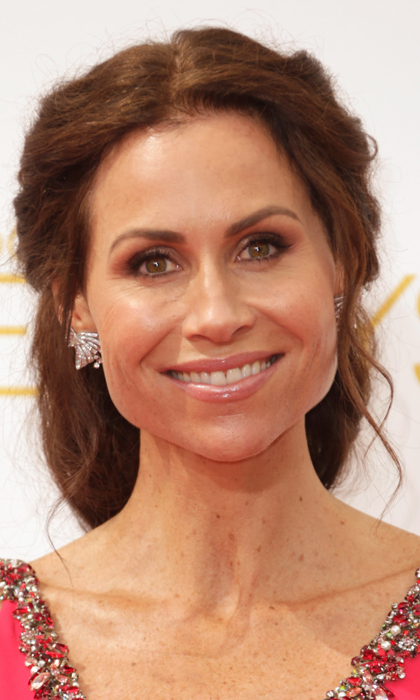 'Return To Zero' nominee Minnie Driver is elegant as ever with a few wispy waves framing her face and perfectly smoky eyes. Like so many at the Emmys this year, she finished the look with a nude lip. © Getty