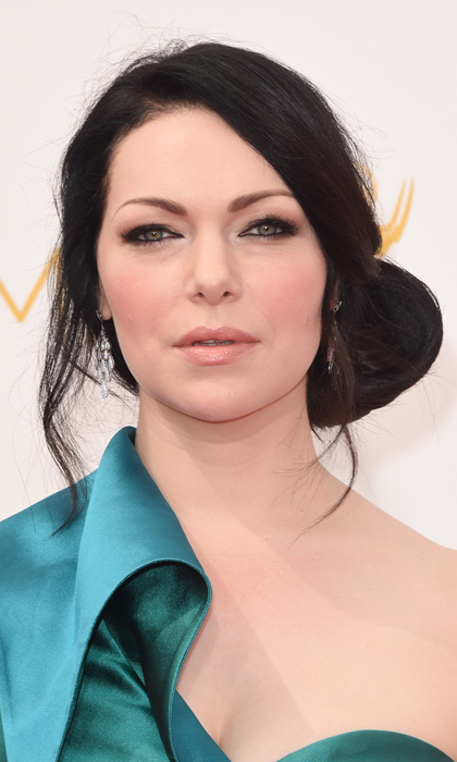The silky curves of Laura Prepon's teal dress are perfectly mimicked by the silhouette of her chic chignon. Keeping the old beauty rule of lips or eyes in mind, the 'Orange Is The New Black' star played up her peepers and kept her lips nude. © Getty