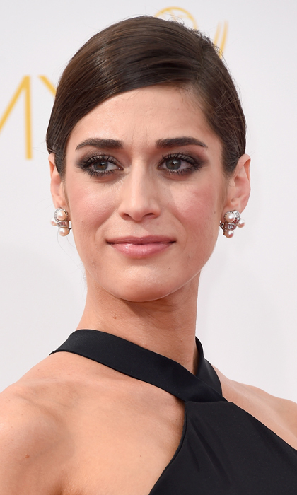 'Master of Sex' nominee Lizzie Caplan was the picture of propriety - unlike her sexually scandalous character - thanks to an elegant updo, boldly black-smudged eyes and - what else? - a nude lip. © Getty