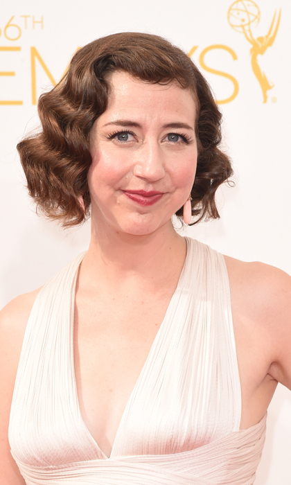 Kristen Schaal did her best Marilyn Monroe on the red carpet, and it's not just the plunging, ruched white dress! Finger waves, berry lips and full lashes are the tools of the trade. © Getty