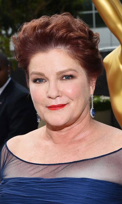 "She may be out of the kitchen, but 'Orange Is The New Black' star Kate Mulgrew isn't giving up her signature ""Red"" lip. The actress added volume to her short auburn locks and brought our her blue eyes with a dazzling pair of drop earrings. © Getty"