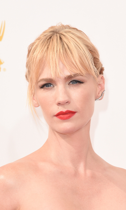 Matching her red lipstick with her scarlet red ball gown, 'Mad Men' star January Jones added some edge to her sweet look with wet, wispy bangs. © Getty