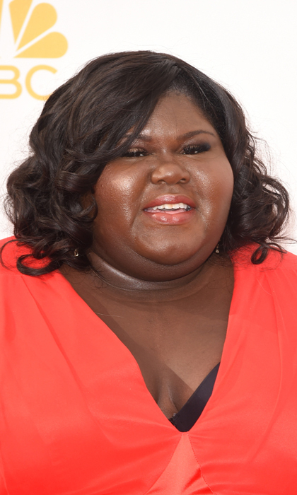 Gabourey Sidibe teamed her perfectly-coiffed curls with a slick of peach lipstick and a smoky eye. © Getty