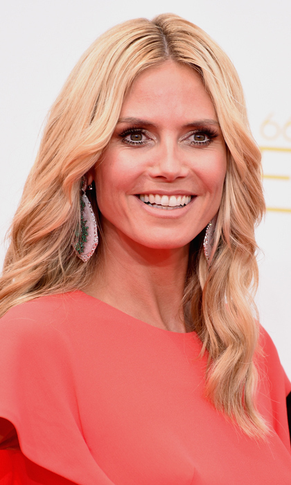 Less is definitely more when you're as beautiful as 'Project Runway' host Heidi Klum. The model kept it simple with a nude lip, soft brown eye makeup and beachy hair waves. © Getty