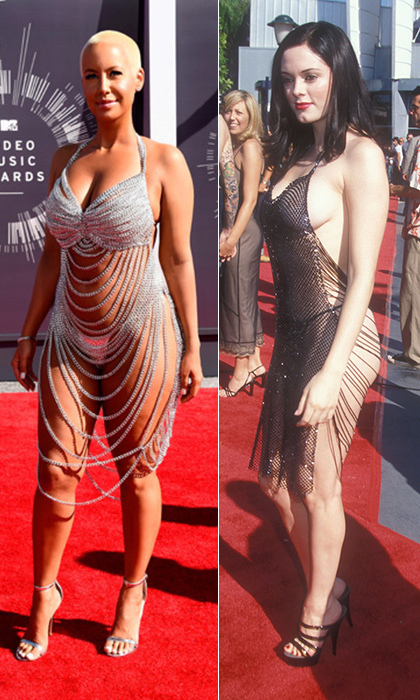 Amber rose to the night's history of wild red-carpet looks - and snagged quite a bit of attention - in a look reminiscent of Rose McGowan's 1998 VMAs dress. The actress caused quite a commotion on the arm of then-boyfriend Marilyn Manson, especially thanks to her exposed derrière. © Getty
