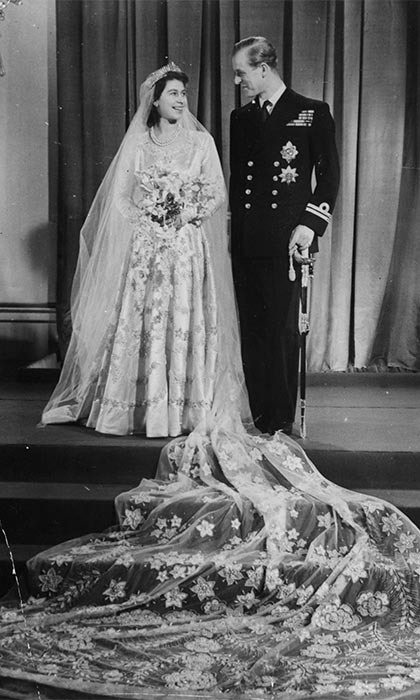 QUEEN ELIZABETH AND PRINCE PHILIP: More than 2,000 guests were in attendance when Queen Elizabeth and Prince Philip became husband and wife at Westminster Abbey on November 20, 1947. The first royal festivity since the end of World War II, the wedding was celebrated across the country. Eight bridesmaids and two pageboys took part in the ceremony, which was officiated by both the Archbishop of Canterbury and the Archbishop of York. The groom presented his princess with a wedding band of Welsh gold to wear alongside her engagement ring.