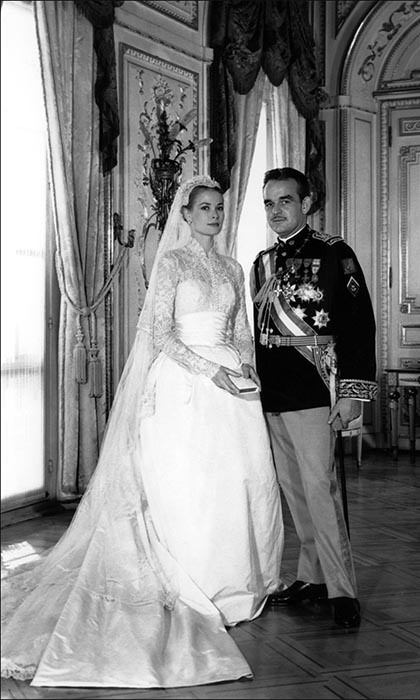GRACE KELLY AND PRINCE RAINIER OF MONACO: The fairytale romance between Hollywood beauty Grace Kelly and her handsome prince, Rainier III of Monaco, culminated in not one, but two lavish wedding ceremonies. On April 18, 1956, the couple were legally wed in the baroque throne room in the Palace of Monaco in a civil ceremony attended by their close family and friends. The next day, Grace and Rainier held a religious ceremony at the Cathedral of Monaco, attended by around 600 guests and watched by an estimated 30 million on television. After the event, the newlyweds drove through the streets of Monte Carlo in an open-top Rolls-Royce – a gift from the people of Monaco – to wave to the thousands of well-wishers. Notable guests at the religious ceremony included Cary Grant, Aristotle Onassis, Ava Gardner and David Niven.