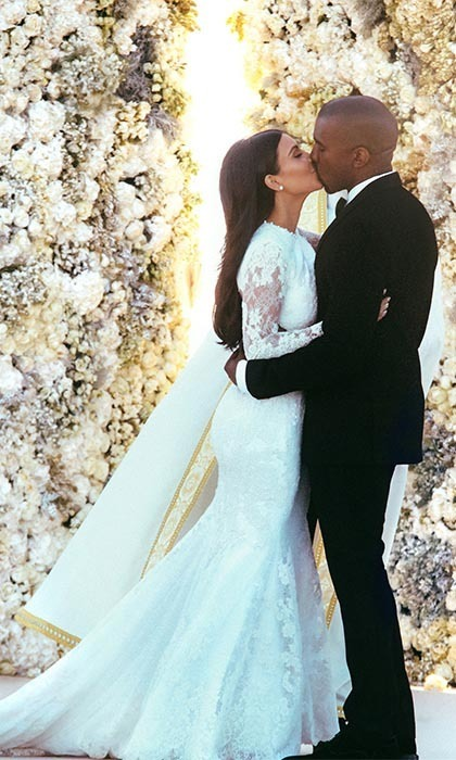 "KIM KARDASHIAN AND KANYE WEST: After months of speculation, the reality TV star and her rapper fiancé tied the knot in front of two giant walls of flowers overlooking Florence, Italy on May 24, 2014. Both Kim and Kanye wore Givenchy for the big day, with Kim changing into a sexier, cream-coloured Balmain dress for the reception. The extravagant reception included a decadent, four-course meal, which was finished off with a white, seven-foot wedding cake. Kanye also made an exuberant and emotional 20-minute speech, in which he praised his wife for being the ""ideal celebrity… the ideal art."""