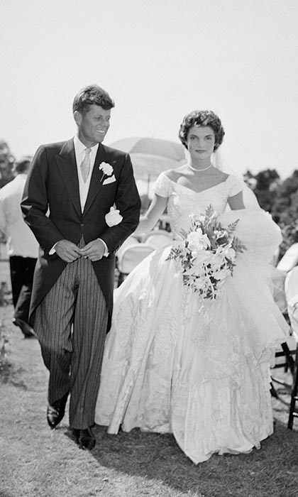 JACKIE AND JOHN F. KENNEDY: When Jacqueline Bouvier wed John F. Kennedy, the former U.S. president's father made sure the nuptials were a sign of the family's high social standing and instructed his son's bride to wear a lavish gown. The First Lady famously chose a voluminous ivory silk taffeta dress by designer Ann Lowe. With more than 900 guests in attendance – including diplomats, society ladies and celebrities – the Sept. 1953 wedding made national news and is largely considered to be one of the most high-profile unions of the 20th century.