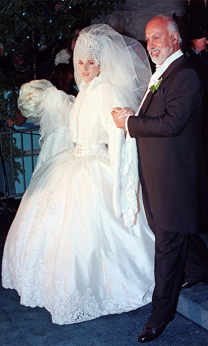 CELINE DION AND RENÉ ANGELIL: French-Canadian super-couple Celine and René were wed on Saturday, Dec. 17, 1994 in an extravagant Montreal ceremony, which was broadcast live on Canadian television. The kooky songstress wore a silk gown by Mirella and Steve Gentile – complete with a 20-foot train – and an enormous, Swarovski-crystal tiara that had to be sewn onto her head!