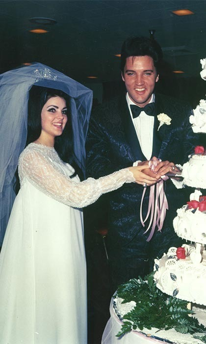 ELVIS AND PRISCILLA PRESLEY: One of the biggest weddings from rock-and-roll history took place on May 1, 1967 – just over seven years after Elvis and Priscilla first met. The eight-minute morning ceremony was held in a second-floor suite in the Aladdin Hotel, Las Vegas, presided over by Nevada Supreme Court Justice David Zenoff. The bride, 21, wore a floor-length wedding gown of white chiffon, trimmed in seed pearls and finished with a three-foot tulle veil secured by a rhinestone crown.