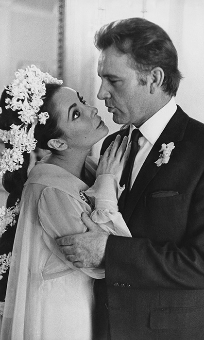 "ELIZABETH TAYLOR AND RICHARD BURTON: While Richard was appearing in 'Hamlet' in Toronto, the A-list pair made an unannounced journey to Montreal, where they were married in a low-key ceremony on Mar. 15, 1964 at the Ritz Carlton Hotel. Only nine people were in attendance to see the lovers pronounced man and wife, including Richard's best man, Jim Benton. ""This marriage will last forever,"" said the bride, while her husband added: ""Elizabeth Burton and I are very, very happy."" Looking every inch a screen goddess, Elizabeth wore an empire-style chiffon gown in daffodil yellow for her wedding to Richard. She finished off the look with the emerald-and-diamond brooch gifted to to her by her husband and a crown of white lilies in her hair."