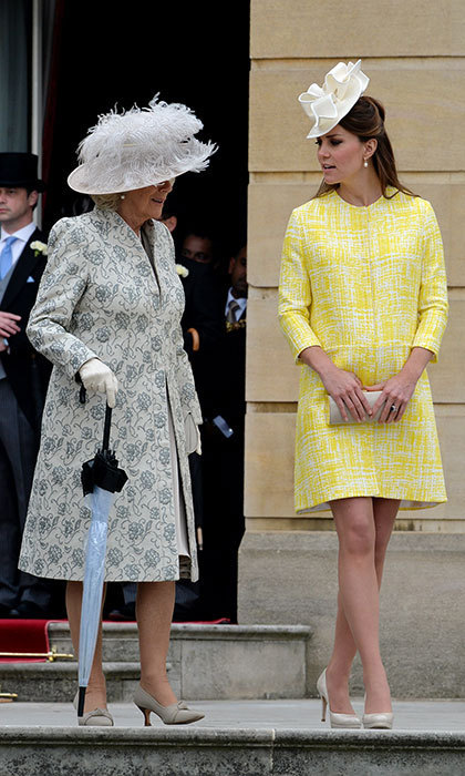 Wow! Kate was bright as can be in a yellow Emilia Wickstead coat dress at the Queen's garden party. Photo: © Getty Images