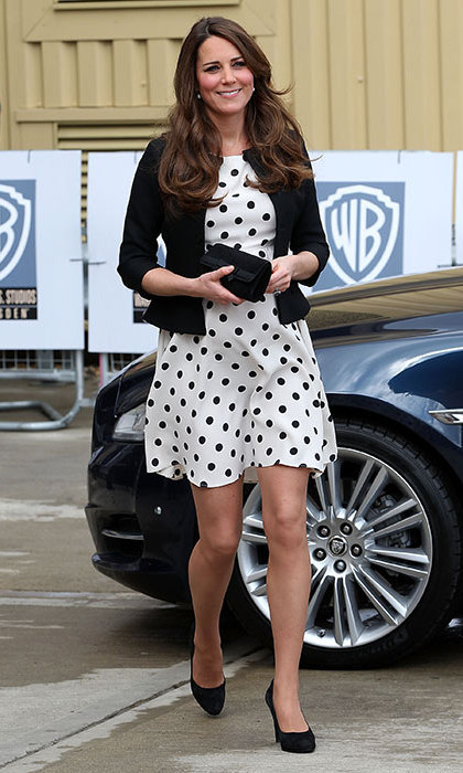 She donned a polka dot dress from Topshop for a visit to the Warner Bros. studios with Prince William and Prince Harry. Photo: © Getty Images