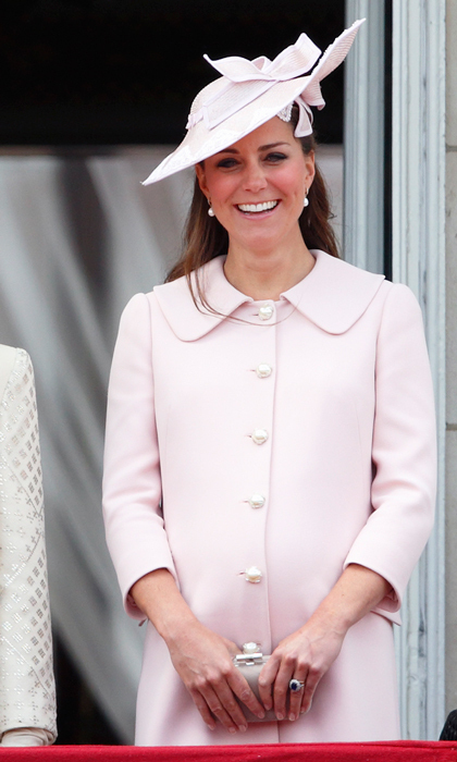 At her final engagement before Prince George's birth, the Duchess looked radiant in a pink Alexander McQueen outfit paired with a jaunty hat and pearl earrings. Photo: © Getty Images