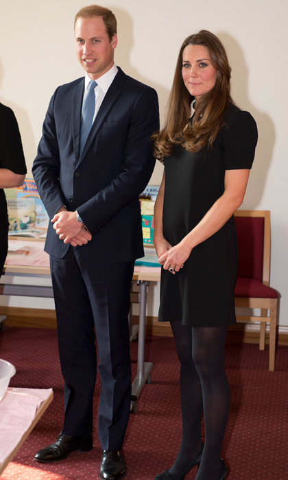 Kate paid a visit to the Child Bereavement Centre in a Topshop shift dress with a white Peter Pan collar, which she teamed with pearl drop earrings. Photo: © Getty Images
