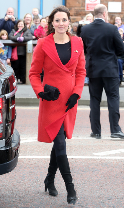It still fits! She brought back a 2006 red coat by Armani for an official outing in Scotland. Photo: © Getty Images