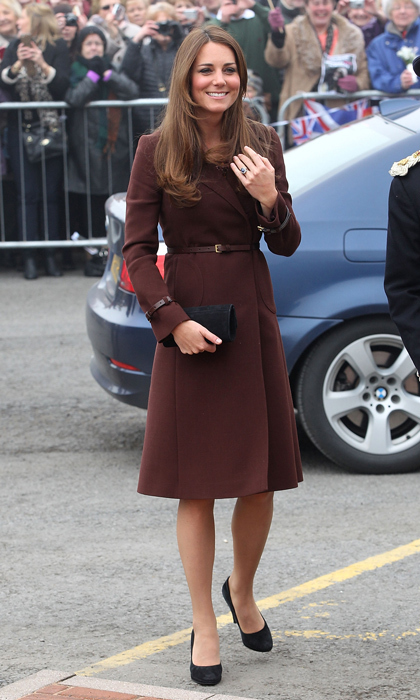 Kate wowed the crowds in a maroon coat during a visit to Grimsby. Photo: © Getty Images