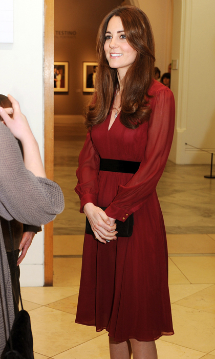 In January, the Duchess was ravishing in her burgundy 'Sofie Rae' dress from Whistles whilst viewing a portrait of herself. Photo: © Getty Images