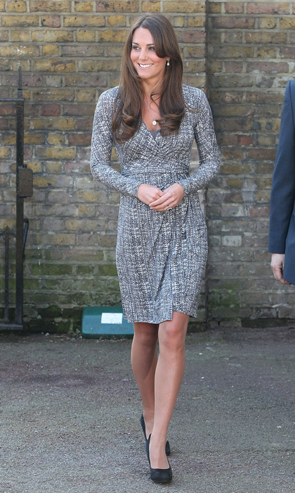 Kate first showed off her baby bump in a black-and-white wrap dress by Max Mara. Photo: © Getty Images