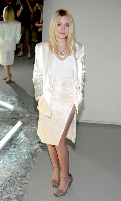 Dakota Fanning was a vision in creamy hues sitting front row at Rodarte. She was sandwiched between Tavi Gevinson and 'Vogue' editrix Anna Wintour. © Getty