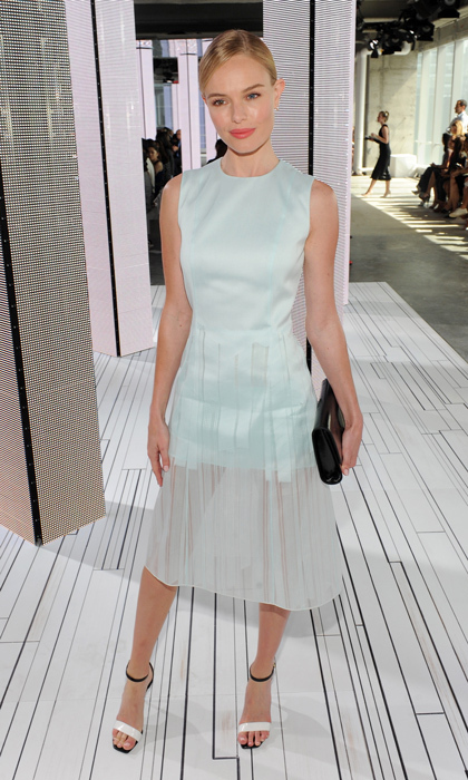 "Kate Bosworth arrived to support Jason Wu at the Boss Women show wearing an icy blue frock, delicately constructed with a striped, sheer overlay skirt. Kate told 'InStyle' that ""it was ethereal. I loved it."" © Getty"