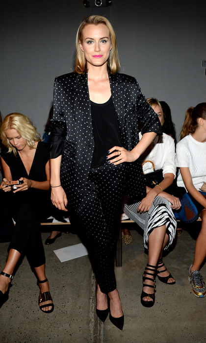 'Orange is the New Black' star Taylor Schilling wowed in a black silk pantsuit sitting front row at Thakoon. The ensemble featured an adorable polka-dot print. © Getty
