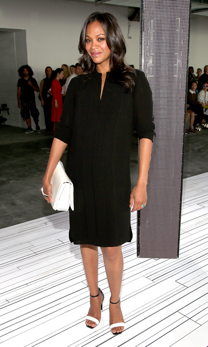 Zoe Saldana looked effortlessly stunning with her growing baby bump swathed in a stunningly simple black dress at the Boss Women showcase. © Getty