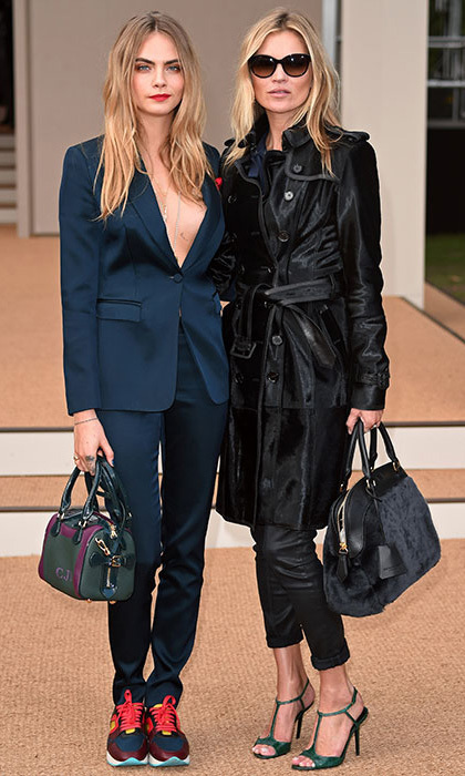 Cara Delevingne and Kate Moss arrived at the Burberry show hand in hand, before sitting on the front row next to Mario Testino. Photo: © Rex