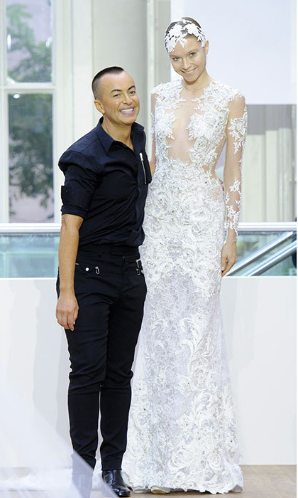Julien Macdonald's stunning bridal gown, a nod to Kim Kardashian's wedding dress, wowed the fashion pack, including FROWers Millie Mackintosh and Abbey Clancy. Photo: © Rex