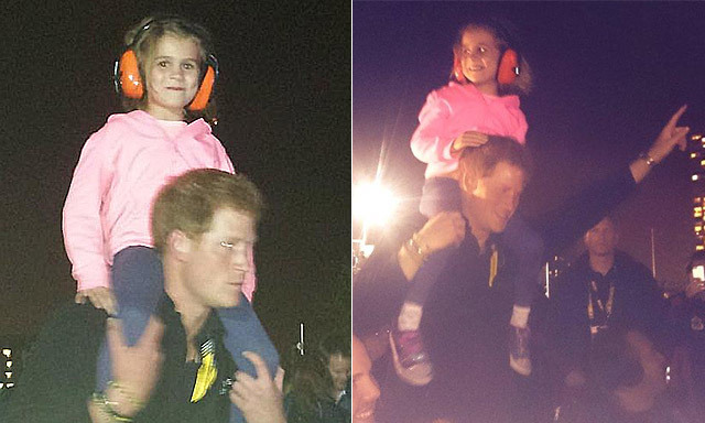 prince harry cheers up young girl with a dance.jpg