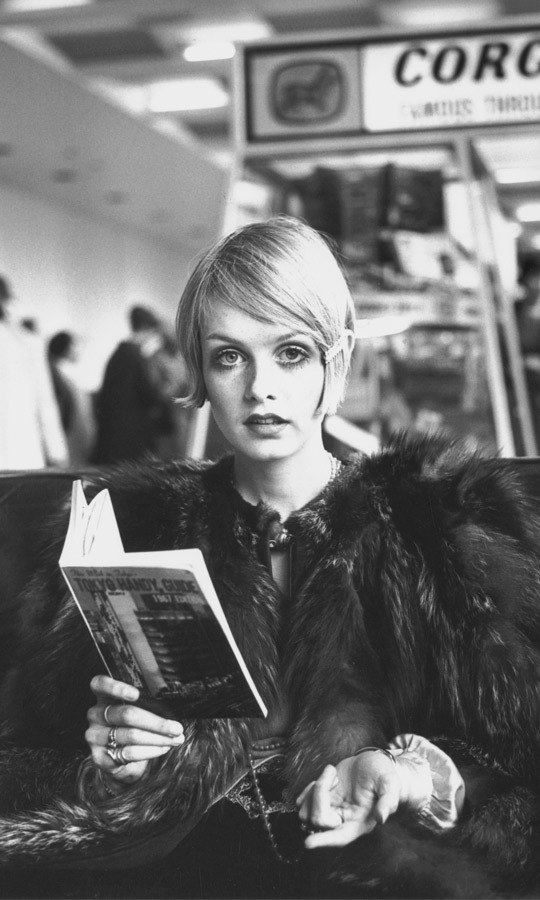1967: Even waiting for a flight, Britain's fashion favourite arrived in style. This photo was captured while the legend was reading a guide book prior to boarding a flight to Japan. (Image: Jim Gray/Getty Images)