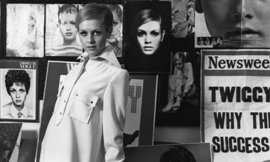 "1967: This portrait of Twiggy features a shirt dress from her own line, but what's most compelling is the sea of past photographs she stands among, including a newspaper clipping that reads, ""Twiggy: Why the Success?"" (Image: Hulton Archive)"