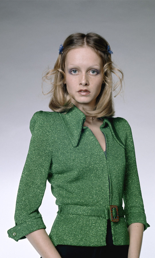1972: This photo, wherein Twiggy wears a green knit jacket with a matching belt, is one of the famed model's more subtle shoots. (Image: Hulton Archive)