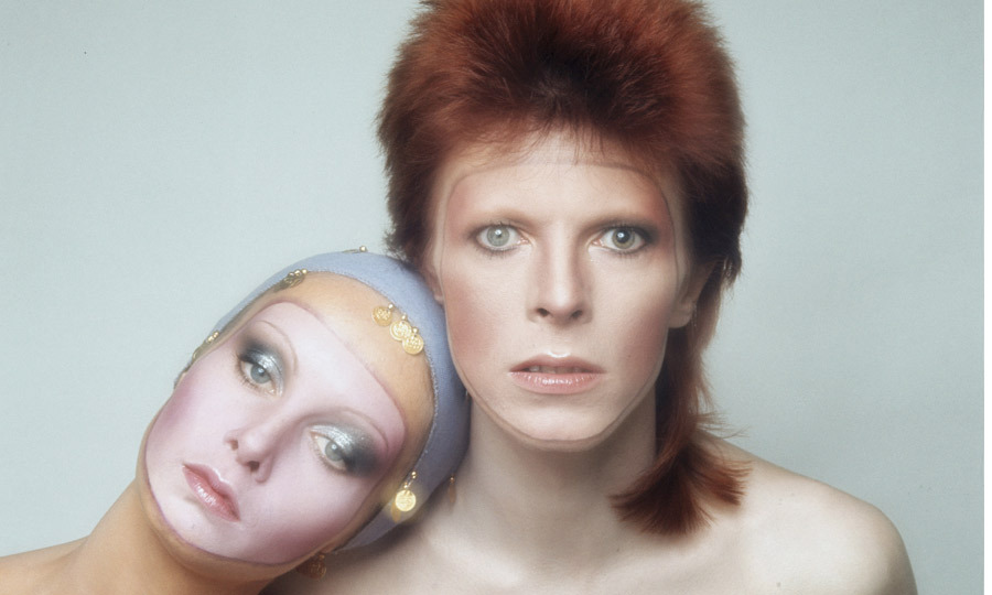 "1973: Twiggy posed for the cover of David Bowie's 'Pin Ups' album in Paris, painted with appropriately futuristic make-up alongside the larger-than-life ""Ziggy Stardust"" crooner. (Image: Hulton Archive)"