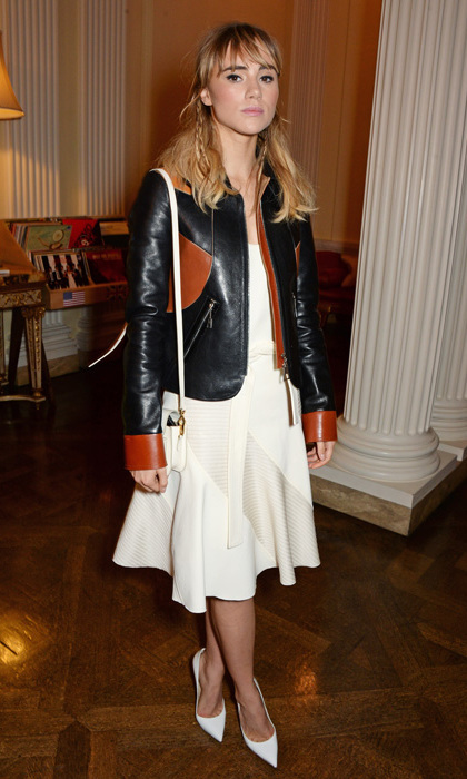 Actress Suki Waterhouse – and girlfriend to Bradley Cooper! – attended the Harrods Shoe Heaven launch party in head-to-toe Louis Vuitton, featuring a colour-blocked leather jacket, ivory A-line dress, pointed-toe pumps and an LV handbag.