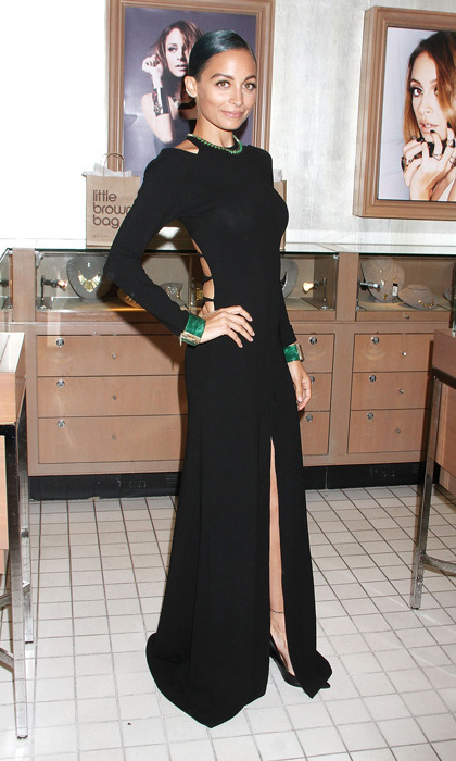Nicole Richie stepped out to promote her latest House of Harlow 1960 collection at Bloomingdale's in a long-sleeved cutout dress by Noam Roach, emerald baubles of her own design and classic black pumps.