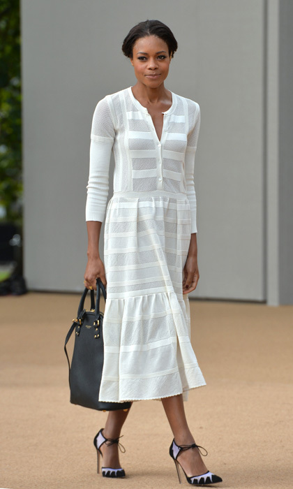 Naomie Harris attended the Burberry Prorsum fashion show in a panelled long-sleeve dress and handbag from the house, Bionda Castana's suede ankle-tie pumps and an ear cuff by Maria Francesca Pepe.