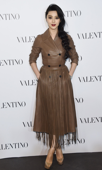 'X-Men: Days of Future Past' actress Fan Bingbing attending the Valentino store opening in Beijing in a fringed leather trench coat and peep-toe platforms.