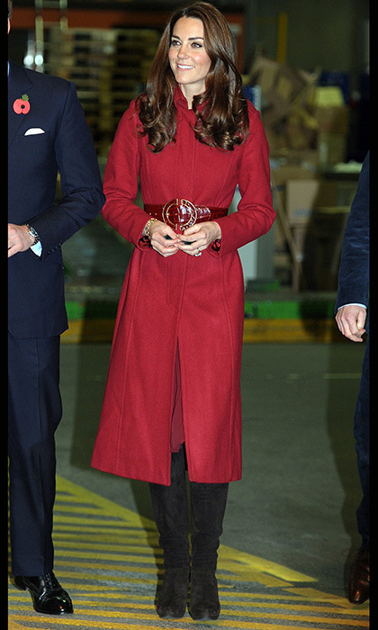 For a trip to Copenhagen, Kate dazzled in a red LK Bennett coat paired with a crocodile skin belt and knee-high suede boots. Photo: © Getty