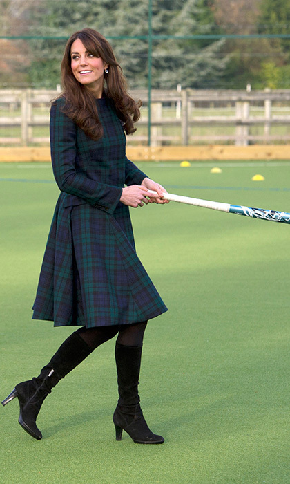 Kate returned to her alma matter, St Andrews, to play a round of field hockey in a green tartan coat by Alexander McQueen. Photo: © Getty