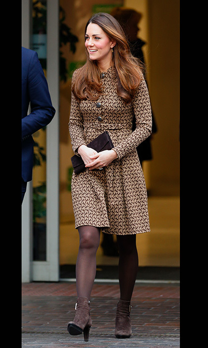The thrifty duchess recycled her favourite brown booties – and her black-and-brown Orla Kiely coat dress – to visit an ex-offender charity, Only Connect, last November. Photo: © Getty