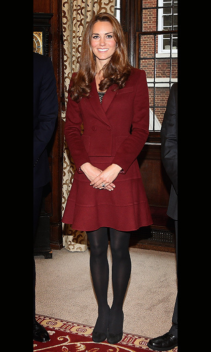 On a visit to Middle Temple, Kate wore a maroon skirt suit by French designer Paule Ka paired with black stockings. Photo: © Getty
