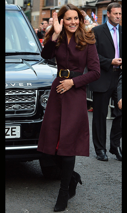 "Accessorizing once again with an oversized belt, Kate wore an aubergine coat by an ""independent British designer"" while on visit to Newcastle. Photo: © Getty"