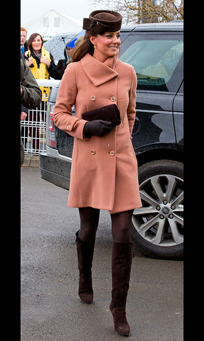 At the Cheltenham Festival, Kate paired her pink Joseph coat with brown patterned tights and brown boots to the knee. Photo: © Getty