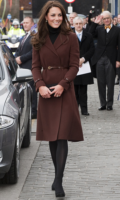 The duchess attended a charitable event in Liverpool in a belted brown coat by Hobbs, which she wore over a cozy black turtleneck. Photo: © Getty